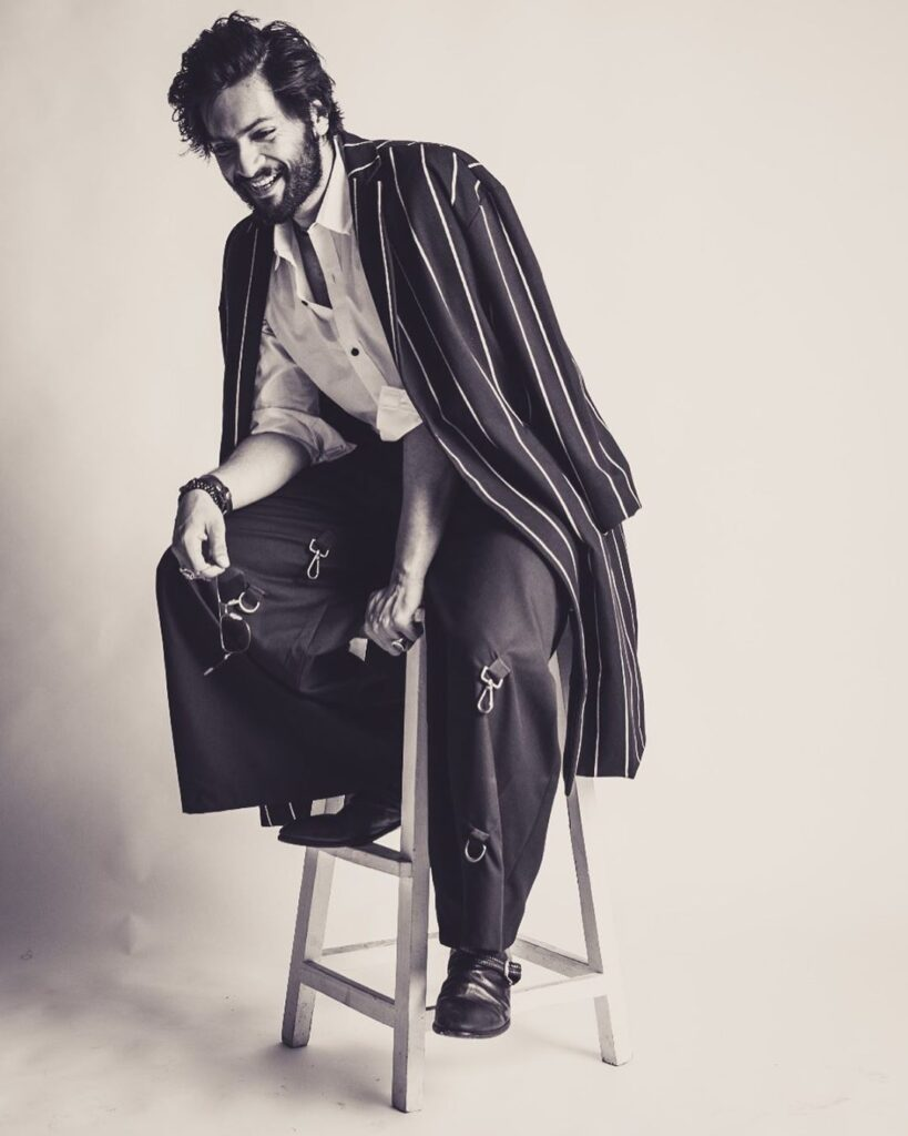 Top Male Model in India - Ali Faizal..Sitting on a stool posing