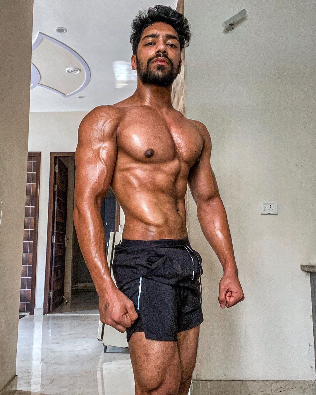 Rohit Khatri top model India - posing and flaunting his chest and abs