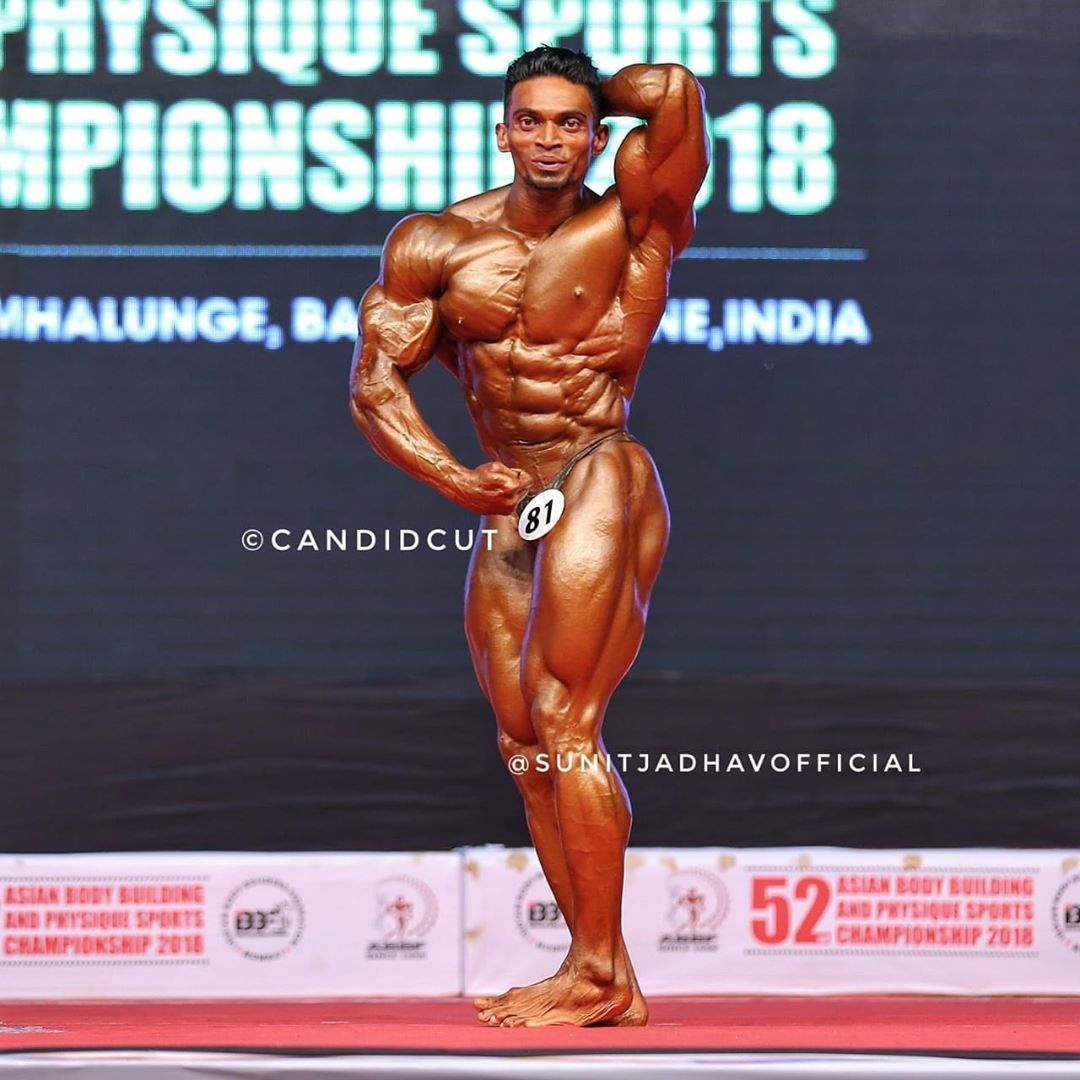 Sunit Jadhav top model India - posing on stage during bodybuilding championship