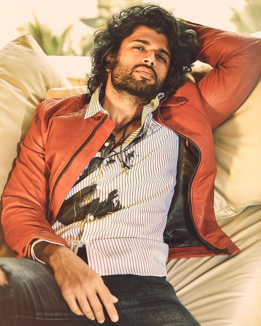 Vijay Deverakonda top model IndiaVijay Deverakonda top model India - lying down on beddown on bed, posing...