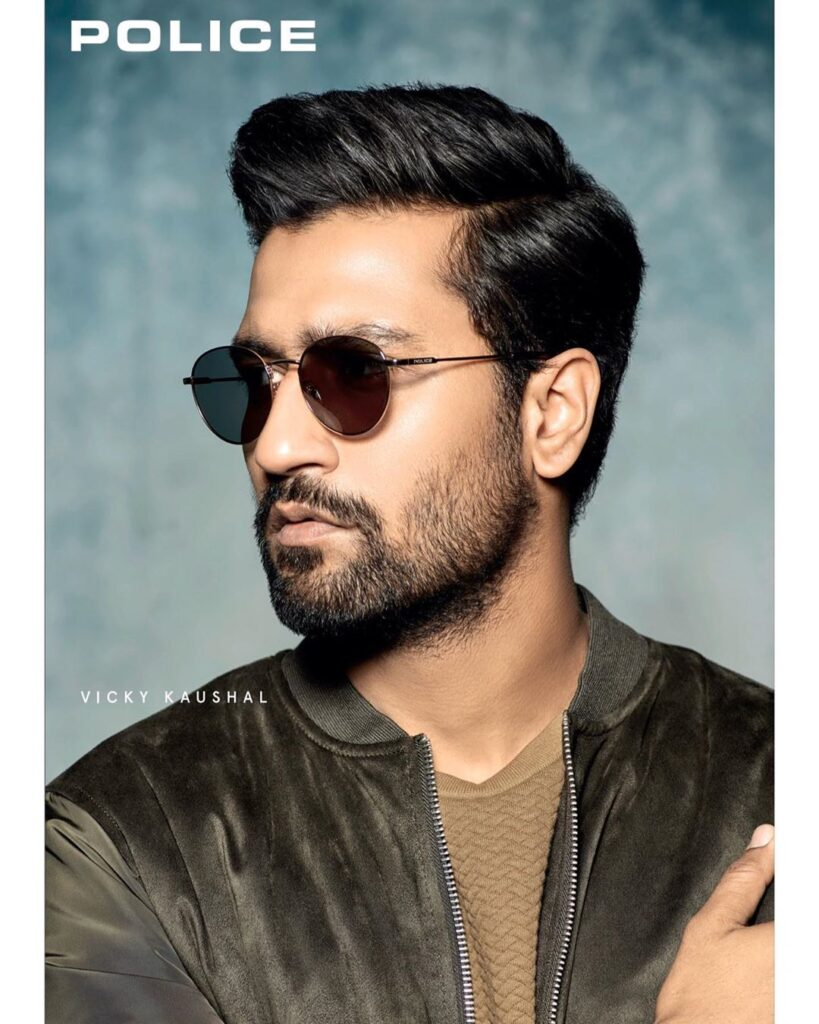 Vicky Kaushal Hairstyle - Have shades and wearing green jacket