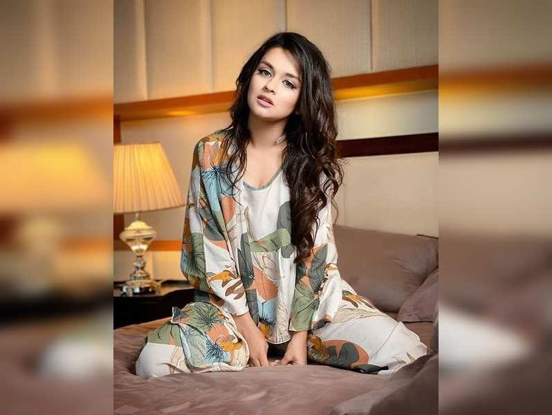 Avneet Kaur - sitting on her bed and posing for camera