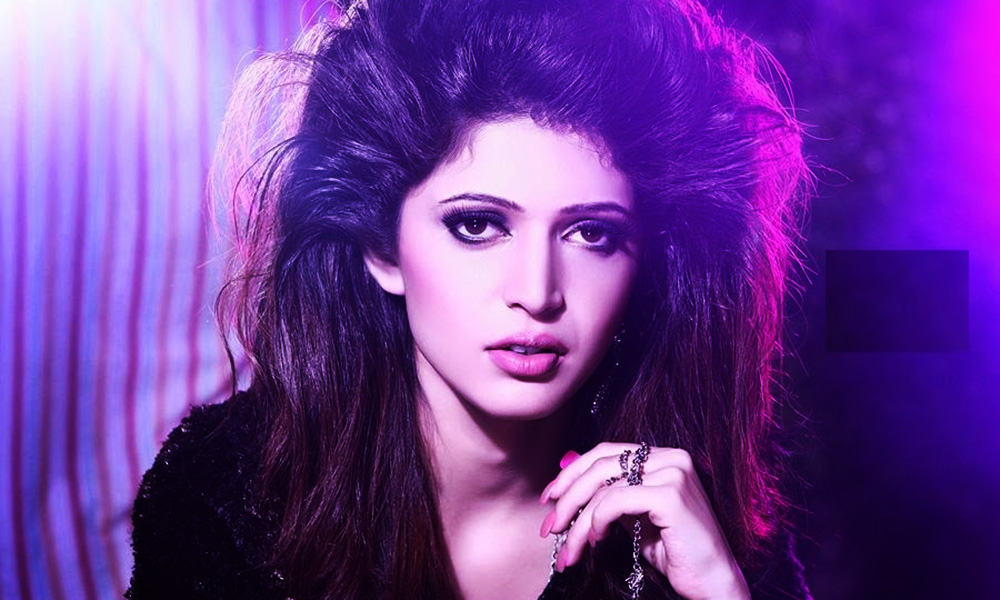 Charlie Chauhan - posing portrait with open hair and black dress