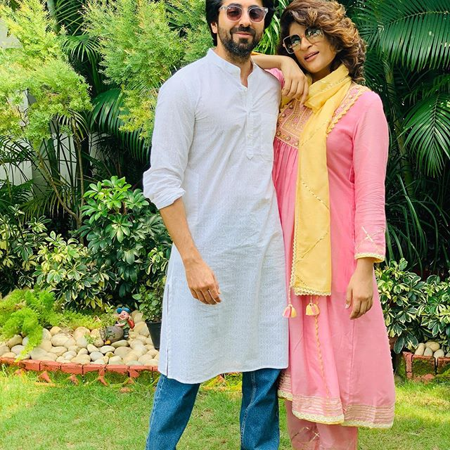 Ayushmann Khurana married to Tahira Kashyap (January) - celebrity couple standing pose together in Indian attires