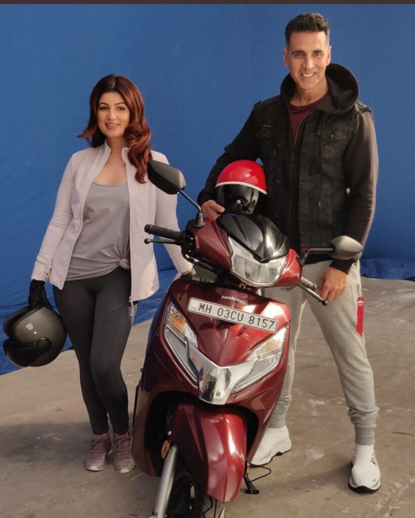 Akshay Kumar married to Twinkle Khanna (December) -  Couple poses with scooty in sports attire