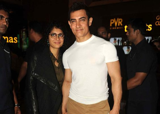 Aamir Khan weds November Born Kiran Rao - both are standing together with wearing black & white outfit
