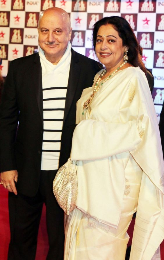 Anupam Kher weds June Born Kirron Kher - Both are looking gorgeous in Indian attire. Kirron is wearing white saree & Anupam Wearing black coat with white t-shirt