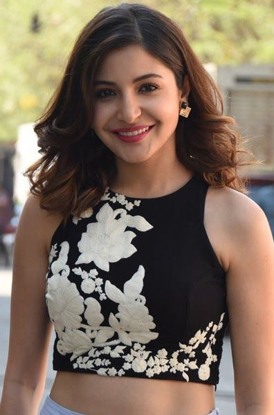 Anushka Sharma wearing black and blue dress in standing pose