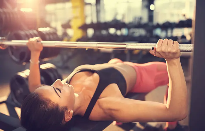 Barbell Bench Press - woman in her active wear