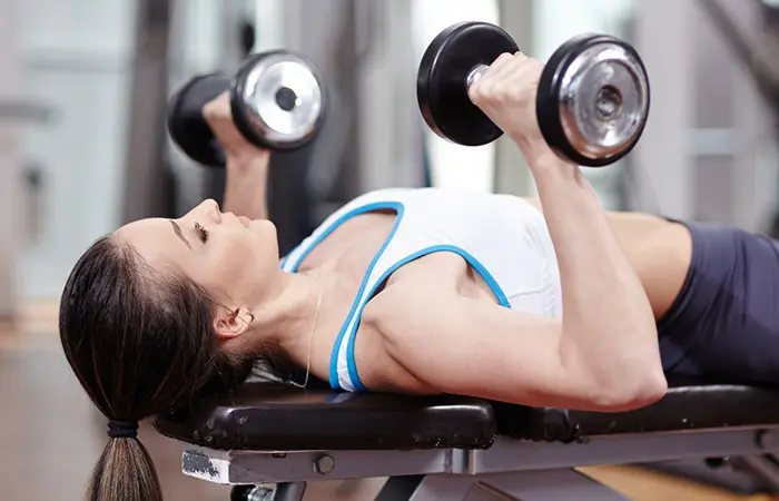 Dumbbell Chest Press - woman in her sports wear