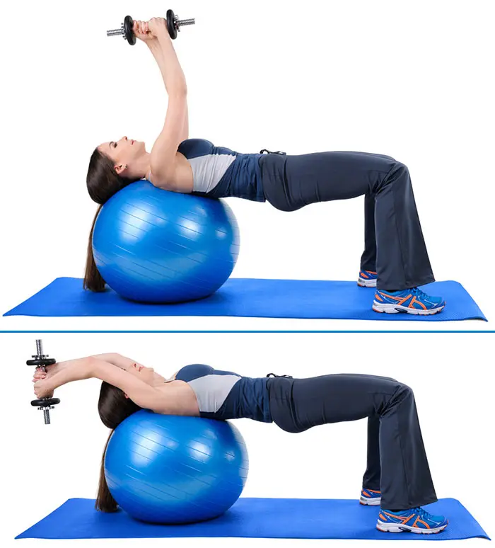 Dumbbell Pullover - woman in her blue sports wear and yoga mat