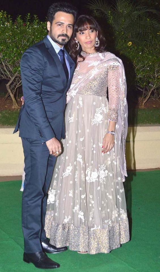 Emraan Hashmi weds February Born Praveen Shahani - both are wearing Indian attire in standing pose