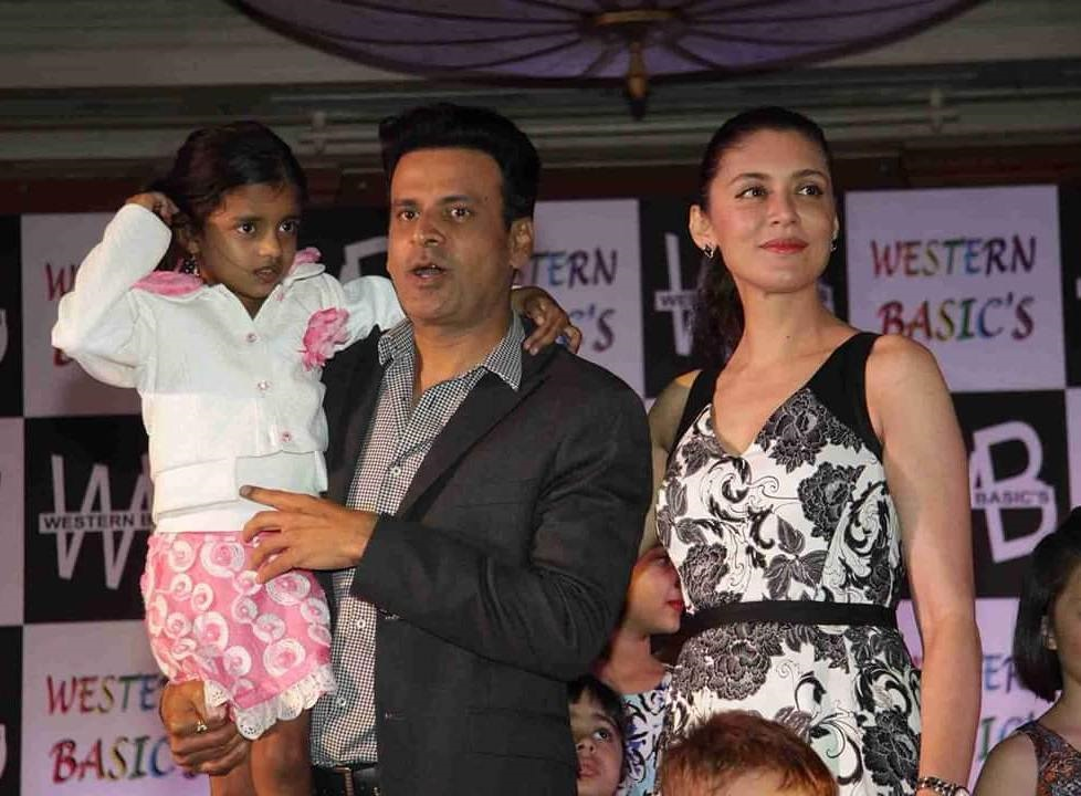 Manoj Bajpayee Weds April Born Neha both are standing together and have their daughter. Wearing western attires