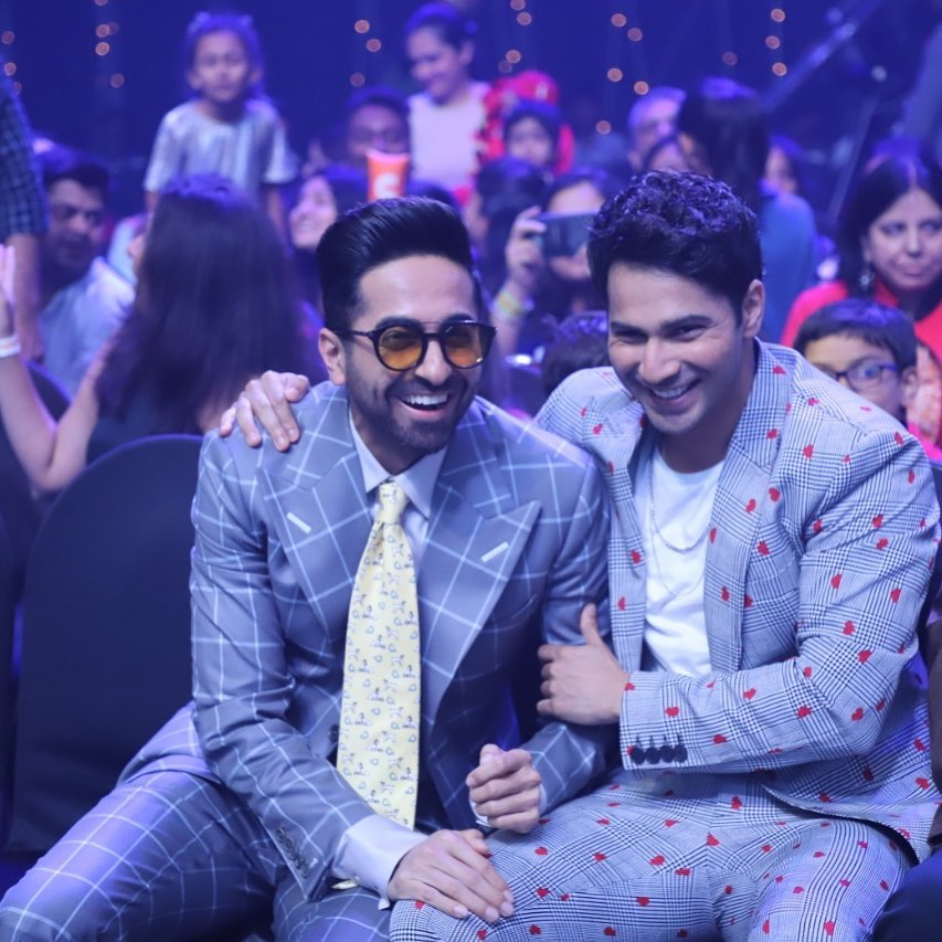 Ayushmann Khurrana sitting with Varun Dhawan Pose with Mild Faded Hair
