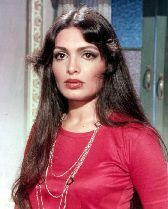 Parveen Babi posing with red dress