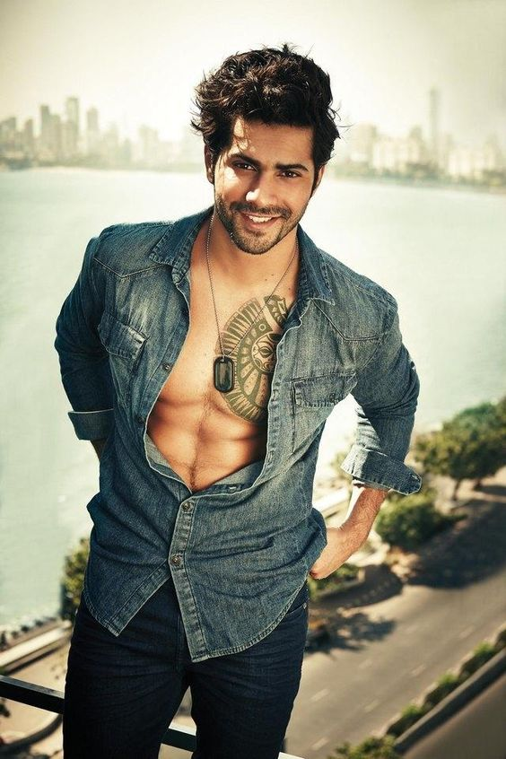 Varun Dhawan standing in open jeans shirt pose