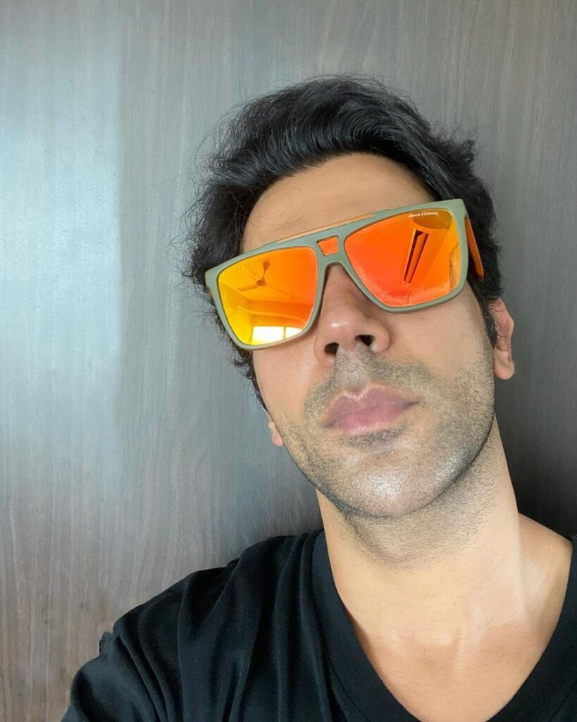 Rajkummar Rao pose with cool guy hairstyle & wearing cool shades