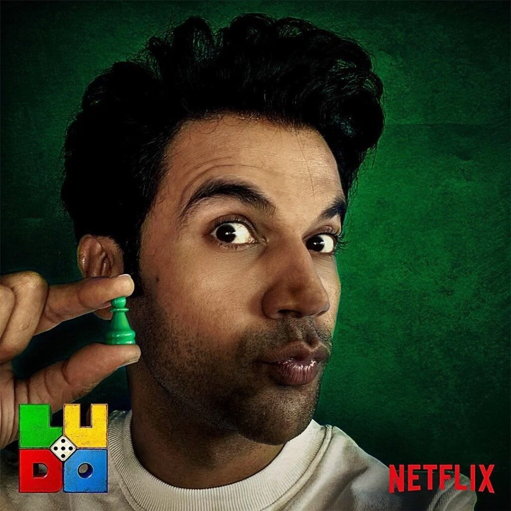 Rajkummar Rao pose with curly hairstyle look & showing ludo dice