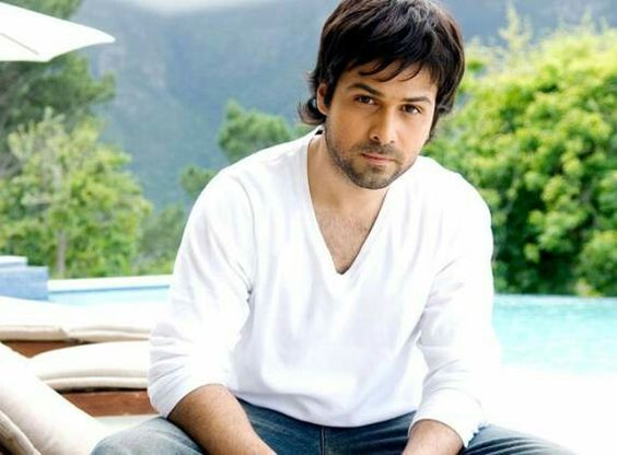 Emraan Hashmi wearing white shirt and blue jeans in pose