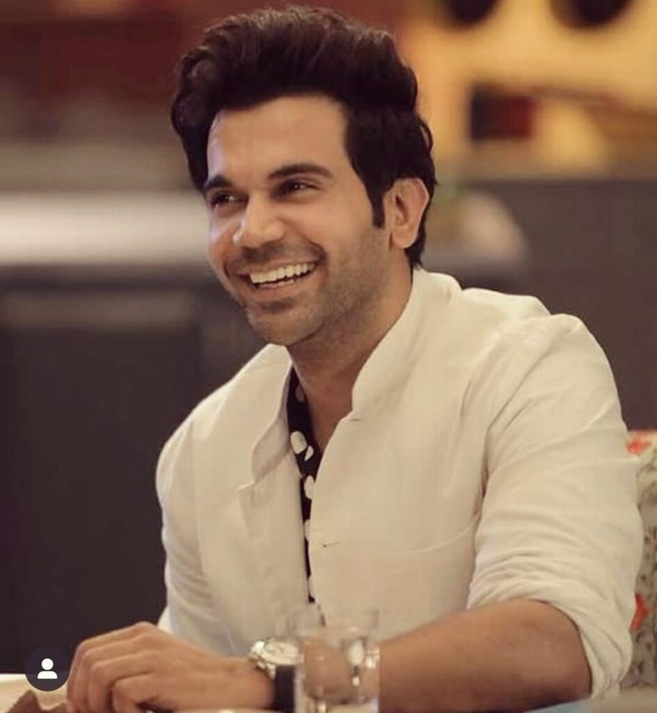 Rajkummar Rao pose with handsome hairstyle & wearing white coat with smile