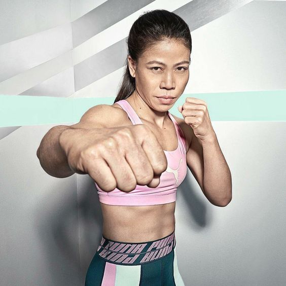 Mary Kom wearing sports outfit in punch pose