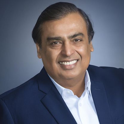 Mukesh Ambani posing with his smile & wearing business suit