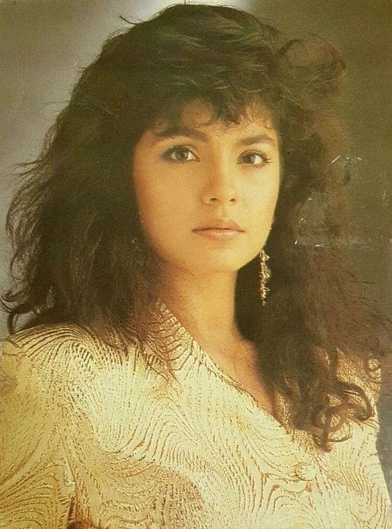 Pooja Bhatt wearing golden dress