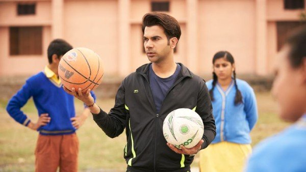 Rajkummar Rao pose sporty look hairstyle & standing in playing area