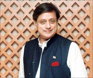 Shashi Tharoor wearing white kurta & black  basket