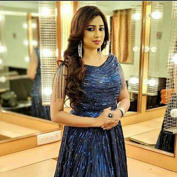 Shreya Ghosal wearing blue dress in standing pose