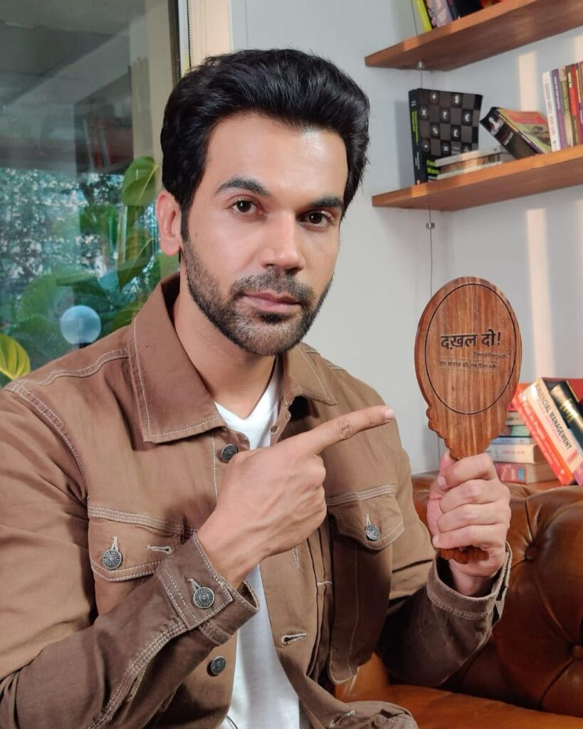 Rajkummar Rao pose with simple casual hairstyle &  pointing out dakhal do caption