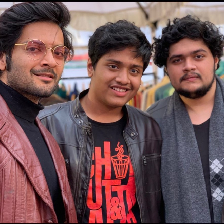 Ali Fazal pose with textured hairdo hairstyle & standing with his known