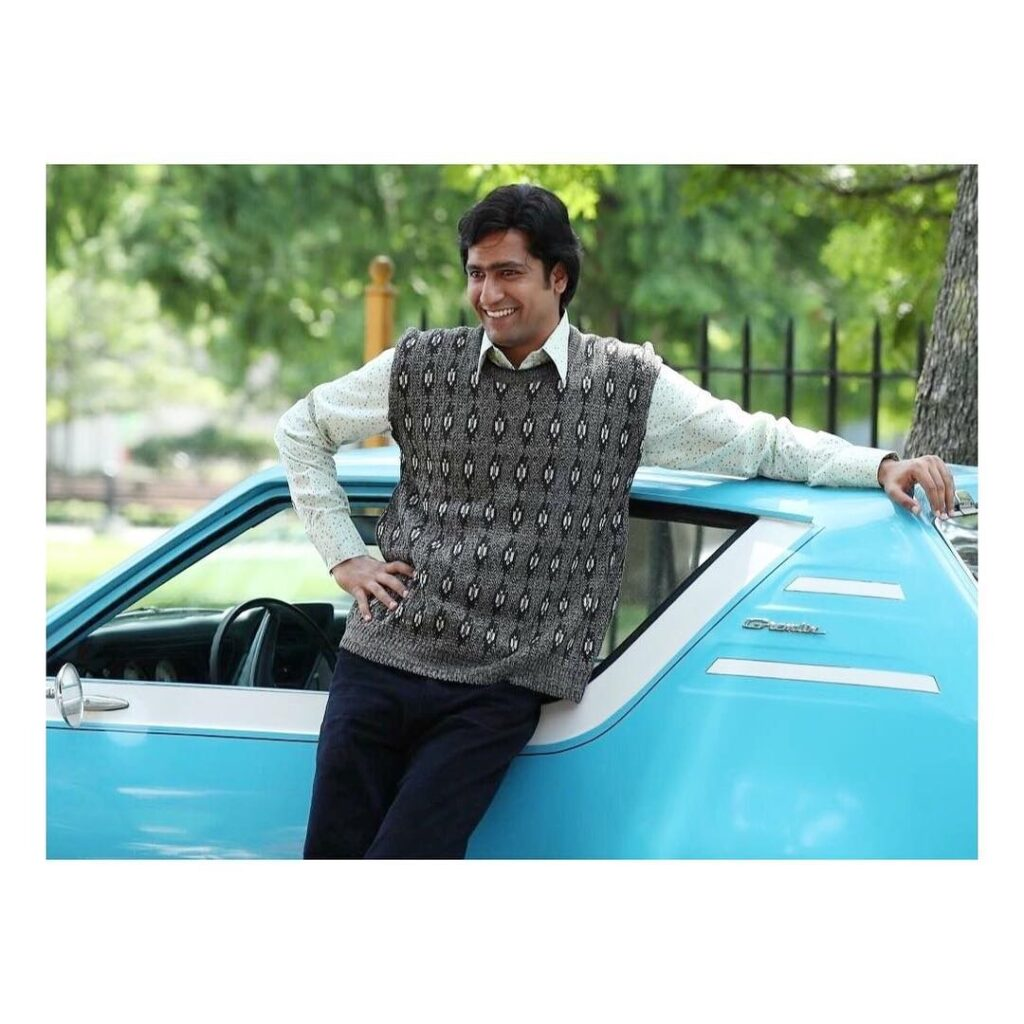 Vicky Kaushal standing in front of car with 90's look
