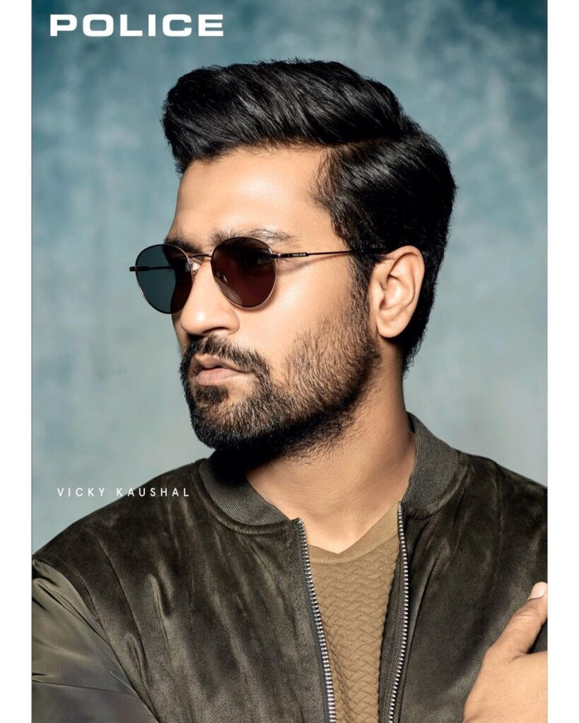 Vicky Kaushal posing in classy badassey look  with shades