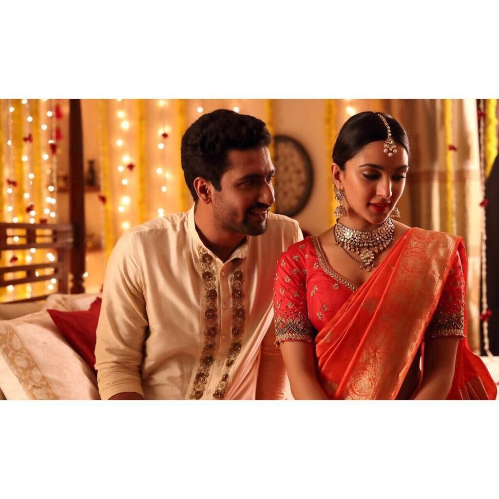 Vicky Kaushal sitting with costar in traditional Indian husband look