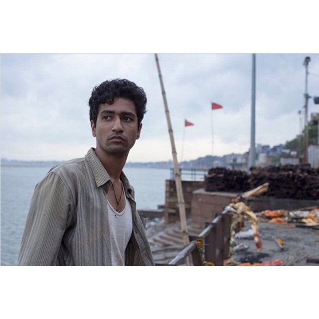 Vicky Kaushal - standing beside the river with soft town boy look