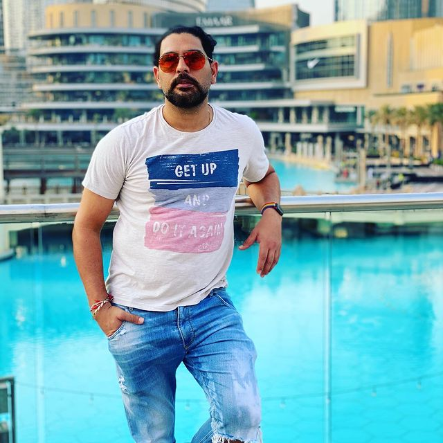 Yuvraj Singh - Standing in front of pool | Dental Implants