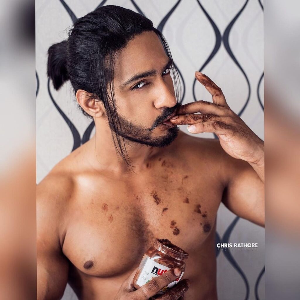 Thakur Anoop Singh the Chocolate-man hairstyles with chocolate eating
