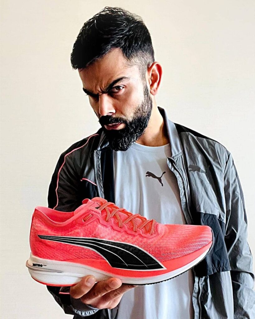 Short hair with beard in angry pose & showing shoe