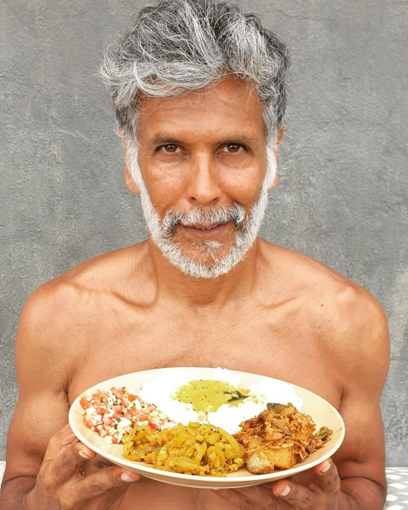 Salt and pepper beard and hairstyle with food showing