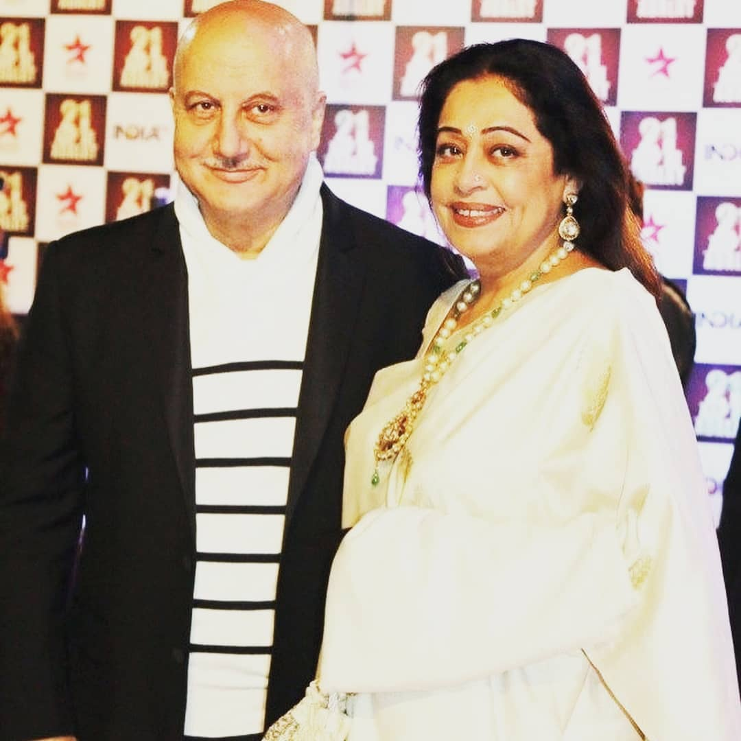 Kirron Kher in white saree posing with husband Anupam Kher - bollywood celebs marry divorced women
