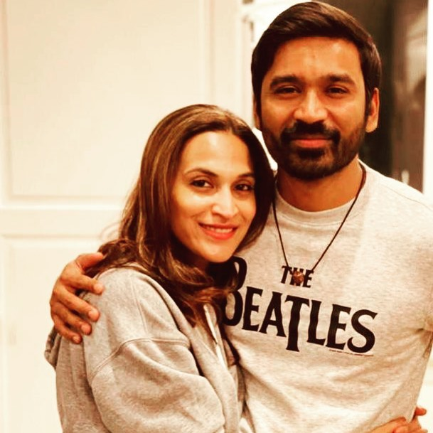 Dhanush and Aishwarya posing for camera in same color outfit - bollywood wives older than husbands