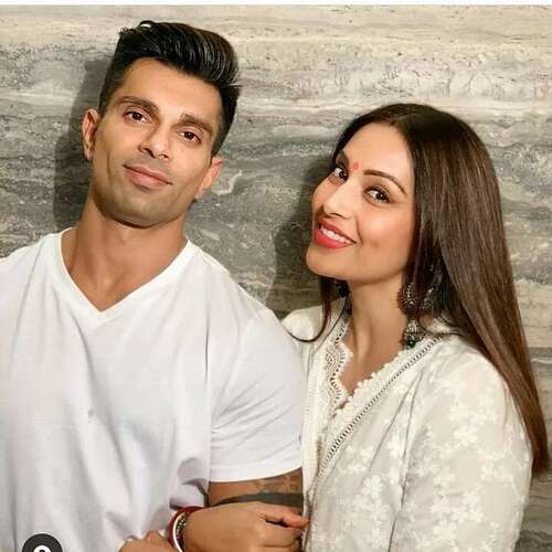 Bipasha Basu holding husband's hand in same white color outfit - celebrity couple age gap