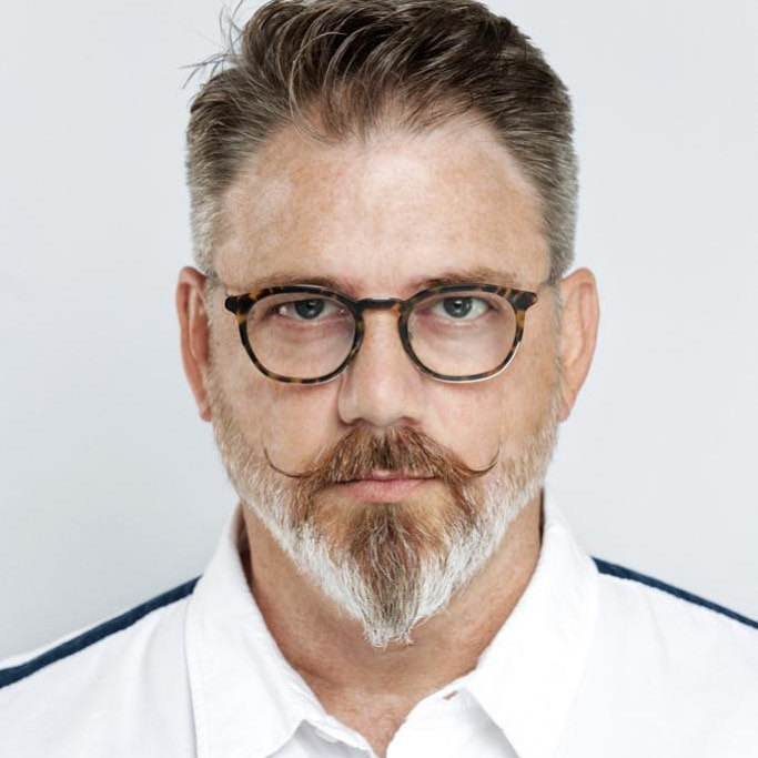 A mature man with spectacles showing off his ducktail beard - Beard Styles For Men 2021