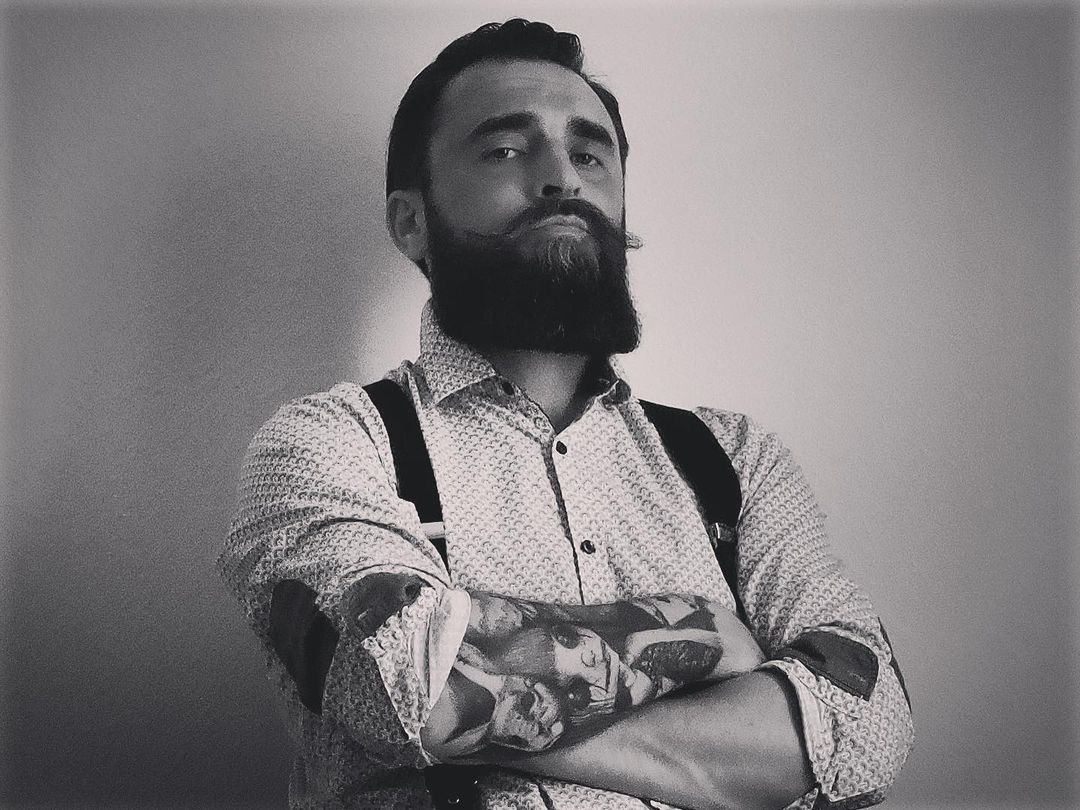 A stud is posing with full french beard -  Beard Styles For Men 2021