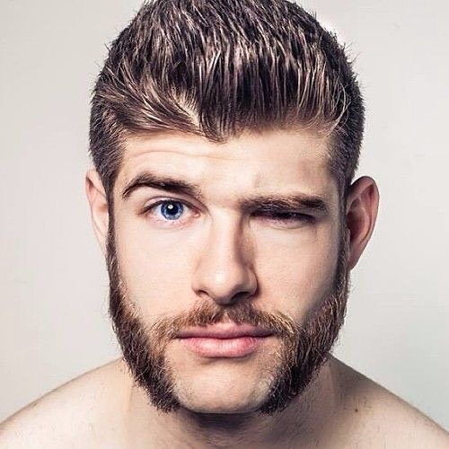 Man is winking and showing his mutton chop beard - Beard Styles For Men 2021