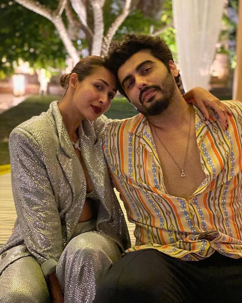 Arjun Kapoor and Malaika Arora siting and posing for camera - celebrity couples