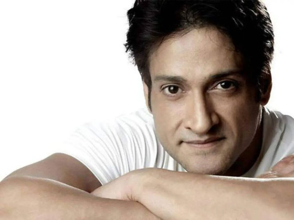 Inder Kumar Posing for camera in white attire - india celebrities who dies of heart attack