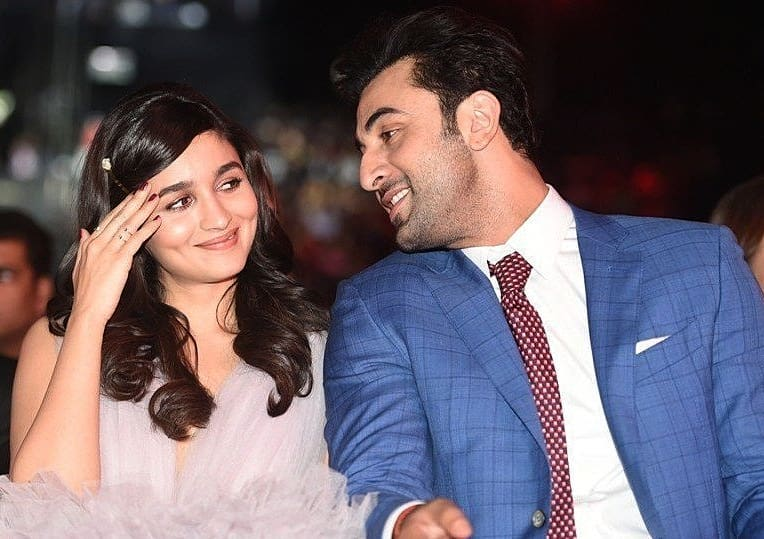 Ranbir Kapoor and Alia Bhatt looking at each other and smiling - bollywood couples