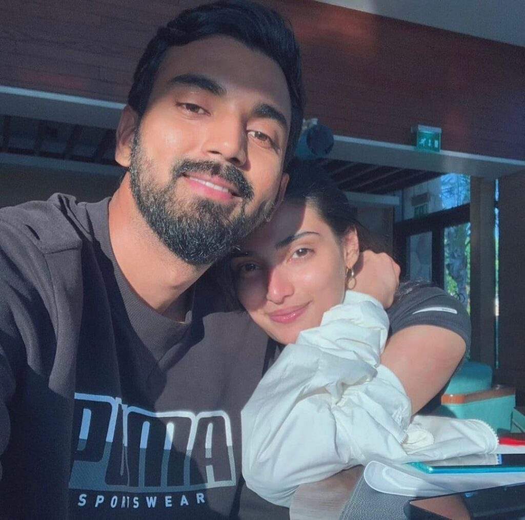 Athiya Shetty and KL Rahul hugging and posing for a selfie - bollywood couples